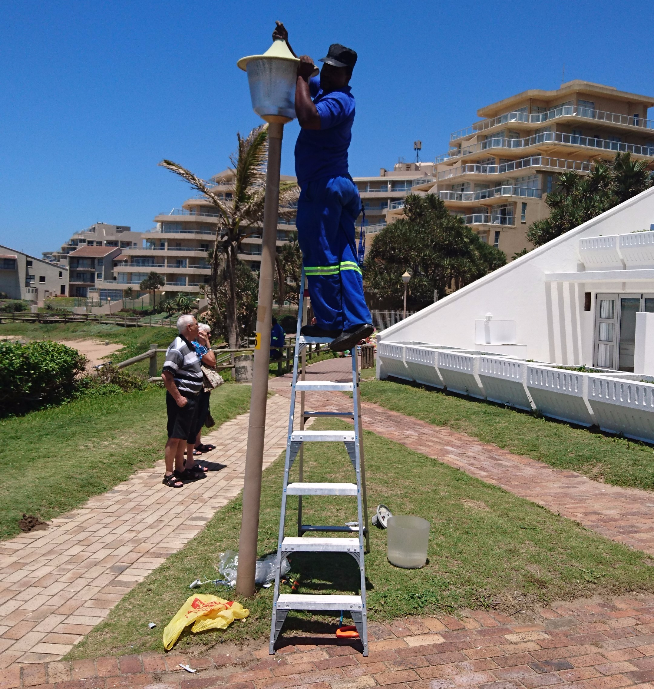 Bheki fixing lights on the promenade