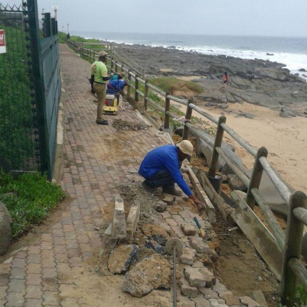Contractors repairing the Ballito boardwalk